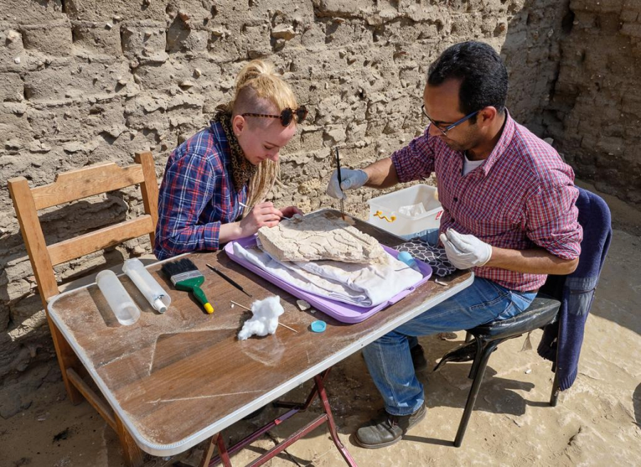 Stephanie and Islam working on an offering table. Photo: Nicola Dell'Aquila.