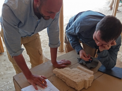 Daniel and Huw deciphering the inscription on an offering table. Photo: Lara Weiss.