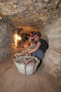 Re-crating the broken crates down in the subterranean complex of Meryneith. Corinna, Christian and Luca helped. Photo: Paolo Del Vesco.